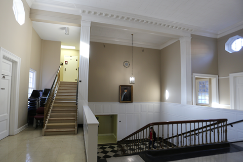 Photo of Stephens Hall staircase and Dr. Edwin Stephen's portrait